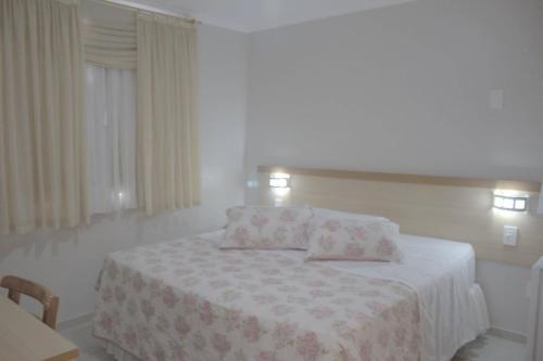 Cama o camas de una habitación en Al-Manara Hotel
