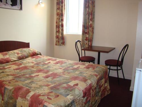 Un ou plusieurs lits dans un hébergement de l'établissement Hotel Quartier Latin