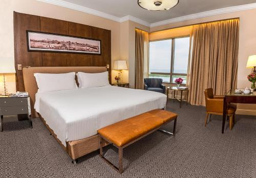 A bed or beds in a room at Alvear Icon Hotel - Leading Hotels of the World