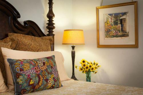 A bed or beds in a room at Four Kachinas B&B Inn