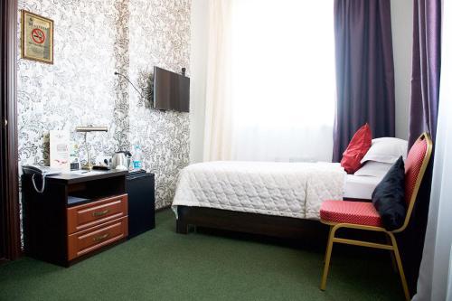 Кровать или кровати в номере Бутик-отель Молли О'Брайн