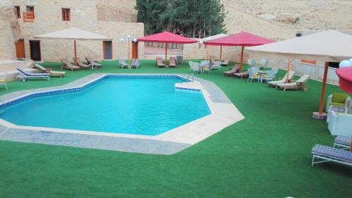The swimming pool at or near Hayat Zaman Hotel And Resort Petra