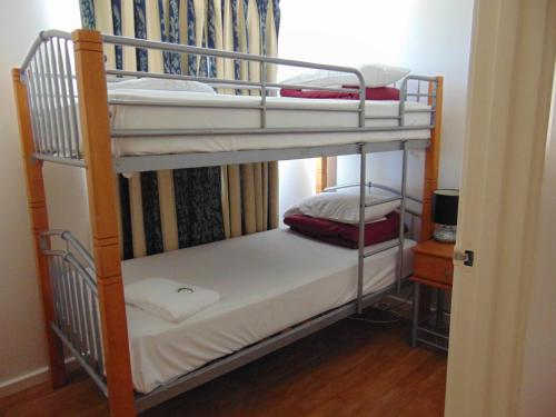 A bunk bed or bunk beds in a room at Fremantle Village