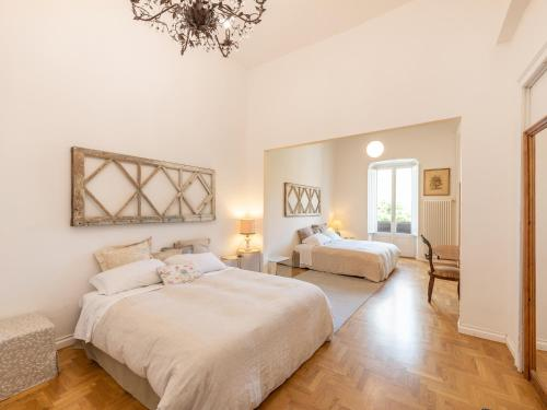 A bed or beds in a room at Sardinia Home Design