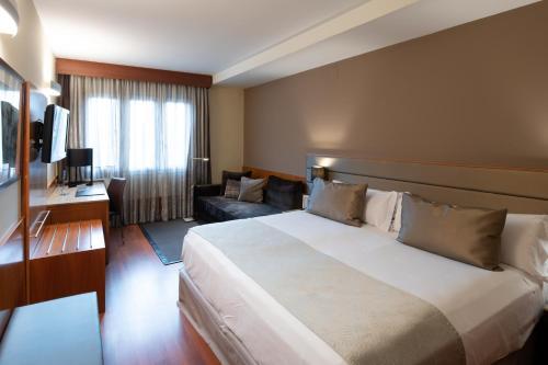מיטה או מיטות בחדר ב-Catalonia Diagonal Centro