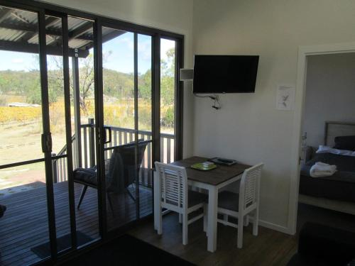 A television and/or entertainment center at Just Red Wines Cabins