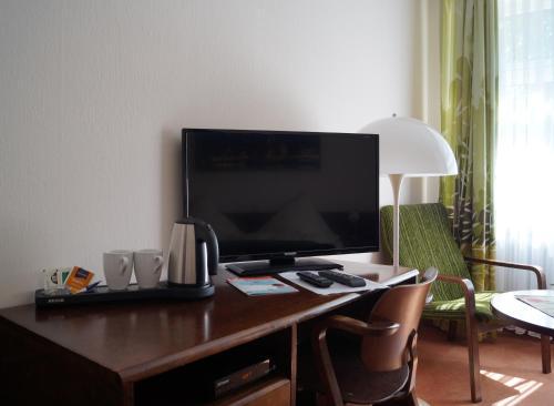 Телевизор и/или развлекательный центр в Hotel Forsthaus St. Hubertus