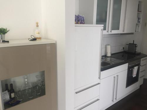 A kitchen or kitchenette at Golfhotel Hebelhof (Wellness-Appartement)