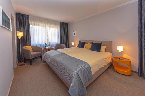Ein Bett oder Betten in einem Zimmer der Unterkunft Wittlers Hotel