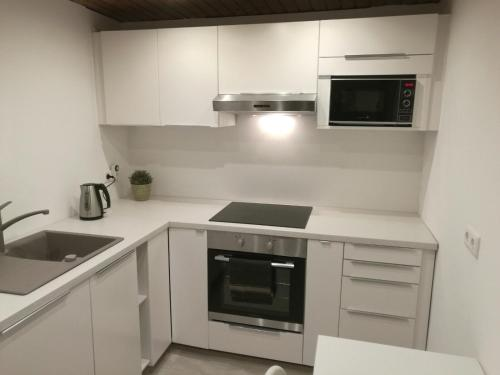 A kitchen or kitchenette at Apartment Cosmelux Nürnberg