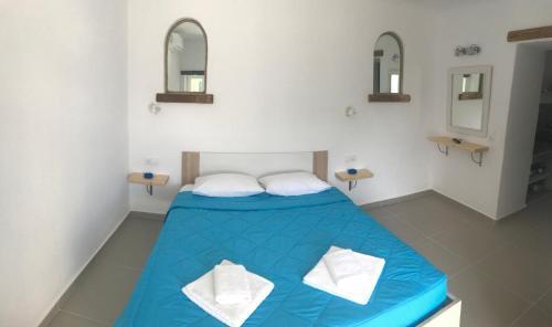 Un ou plusieurs lits dans un hébergement de l'établissement Apostolis Windmill