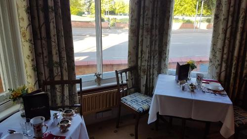 A restaurant or other place to eat at Holywell House