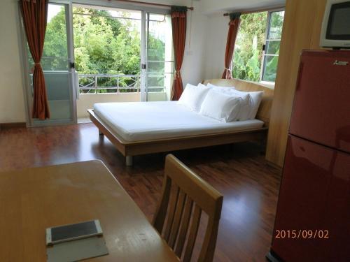Кровать или кровати в номере Sandy Serviced Apartment