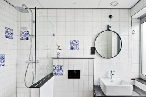 Een badkamer bij Urban Lodge Hotel