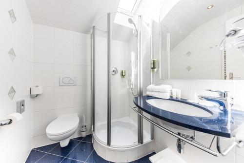 Ein Badezimmer in der Unterkunft Hotel Mondschein