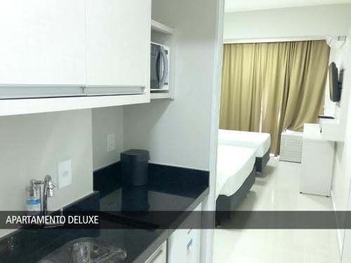 A kitchen or kitchenette at GET Apart Hotel - Garvey
