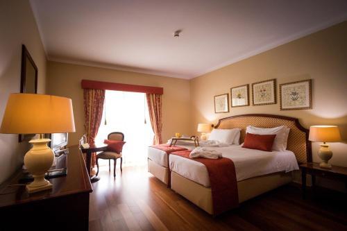 Cama o camas de una habitación en Hotel Talisman