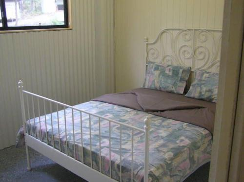 A bed or beds in a room at Hakuna Matata