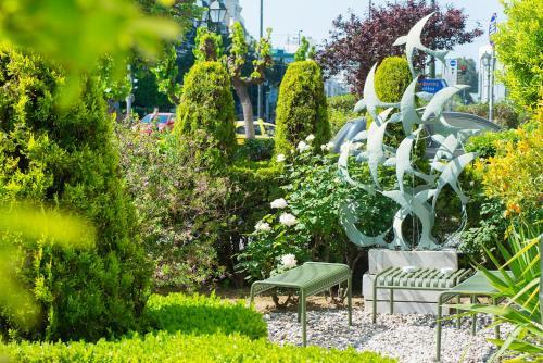 A garden outside Athinais Hotel