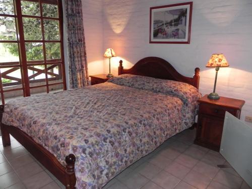 Una cama o camas en una habitación de Vacances Golf