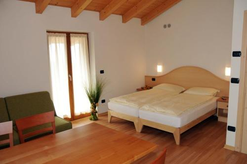 A bed or beds in a room at Agritur alla Veduta