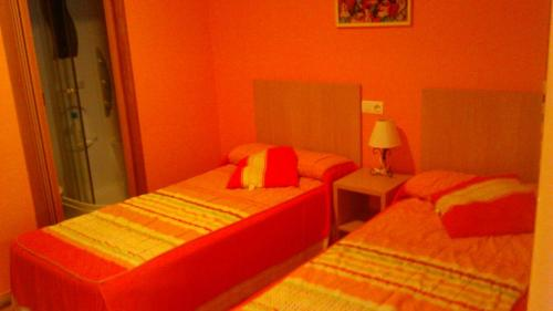 A bed or beds in a room at pension compas