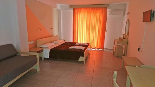 Ένα ή περισσότερα κρεβάτια σε δωμάτιο στο Christakis