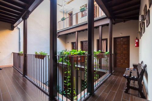A balcony or terrace at Hotel Patio de las Cruces