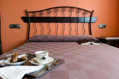 A bed or beds in a room at Casa Goas