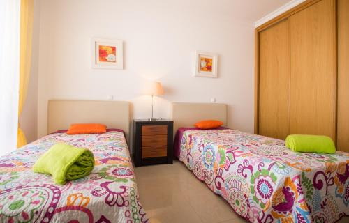 A bed or beds in a room at Capa House