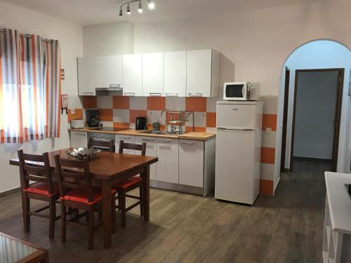 A kitchen or kitchenette at Zesty Orange by ITHOUSE