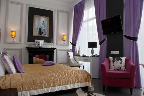 Кровать или кровати в номере Миракс Бутик Отель