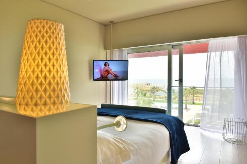 A television and/or entertainment center at Pestana Alvor South Beach Premium Suite Hotel