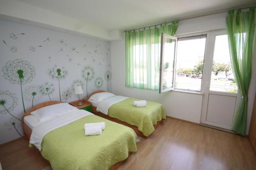 A bed or beds in a room at City Center Accommodation