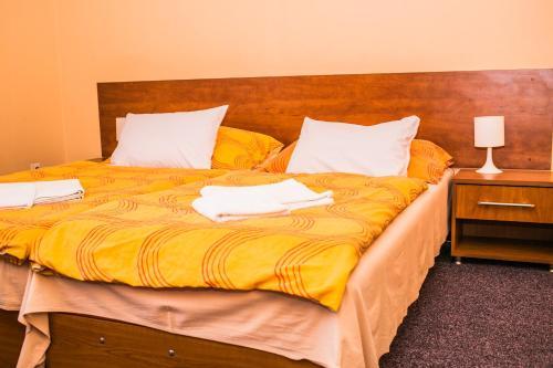 Posteľ alebo postele v izbe v ubytovaní Penzion Fako