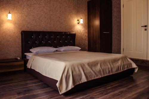Кровать или кровати в номере Гостевой дом «Сокольский»