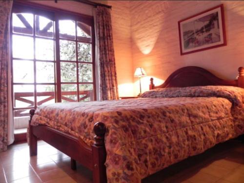 Una cama o camas en una habitación de Vacances Dorado