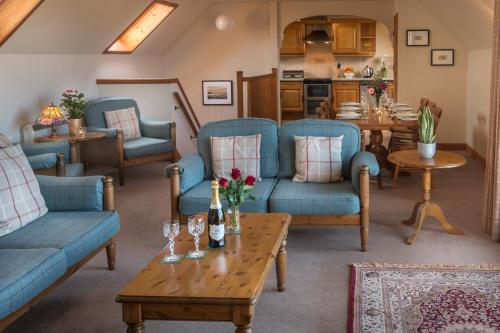 A seating area at Carden Holiday Cottages - Elgin