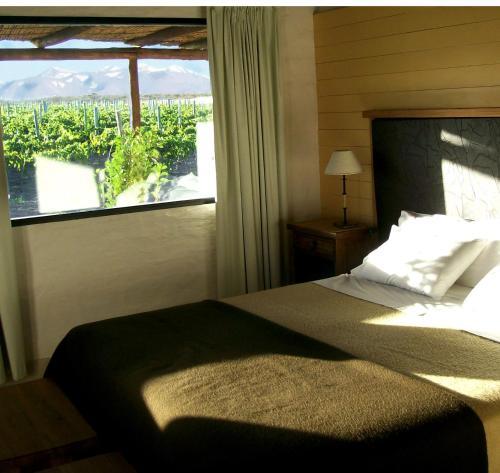 Una cama o camas en una habitación de Tupungato Divino