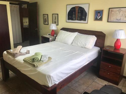 A bed or beds in a room at Gastronomical Centre San Jose
