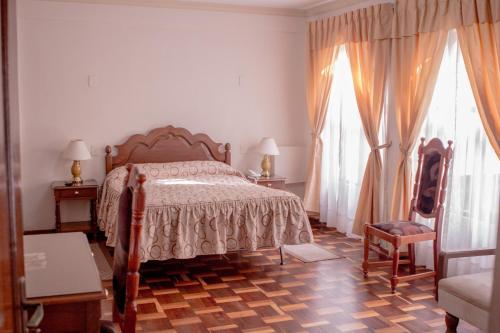 Cama o camas de una habitación en Hostal España