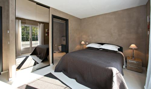 A bed or beds in a room at Villa Casabianca