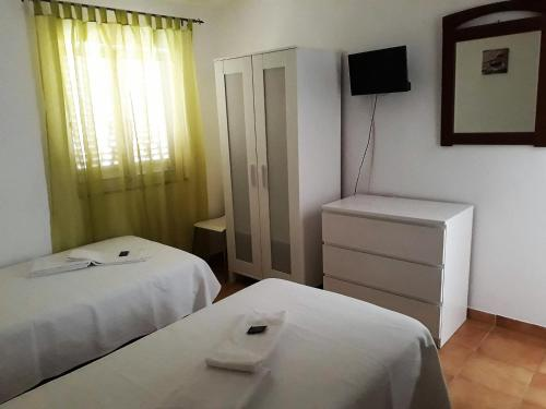 A bed or beds in a room at Residencial Espadinha