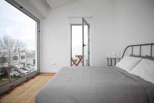 A bed or beds in a room at Place Of Moments Urban