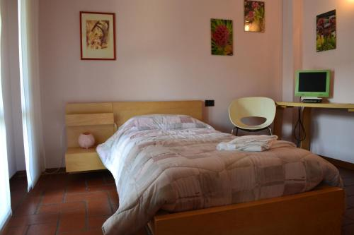 A bed or beds in a room at B&B Orio BGY