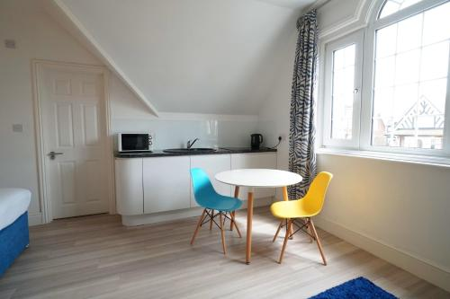 A kitchen or kitchenette at One Helena Road Serviced Apartments