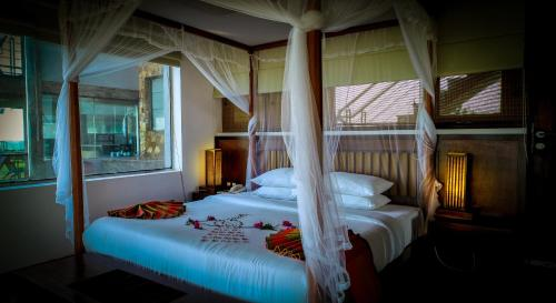 A bed or beds in a room at Laya Safari Resorts & Spa
