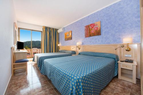 A bed or beds in a room at Hotel Cartago - All Inclusive