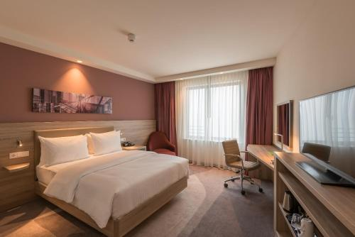 A bed or beds in a room at Hampton By Hilton Frankfurt City Centre East