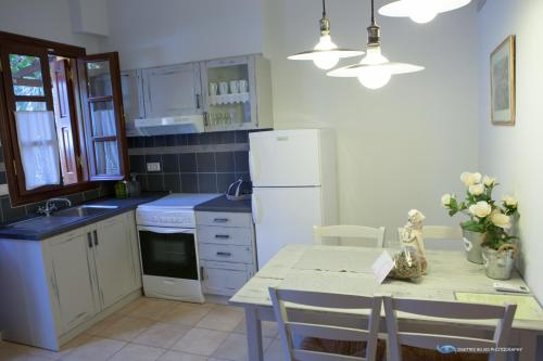 A kitchen or kitchenette at Iapetos Village